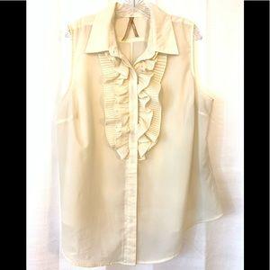Avenue cream colored ruffled sleeveless blouse